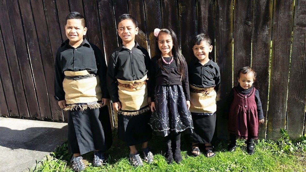 Five young Tongan children dressed for church in ta'ovala. .